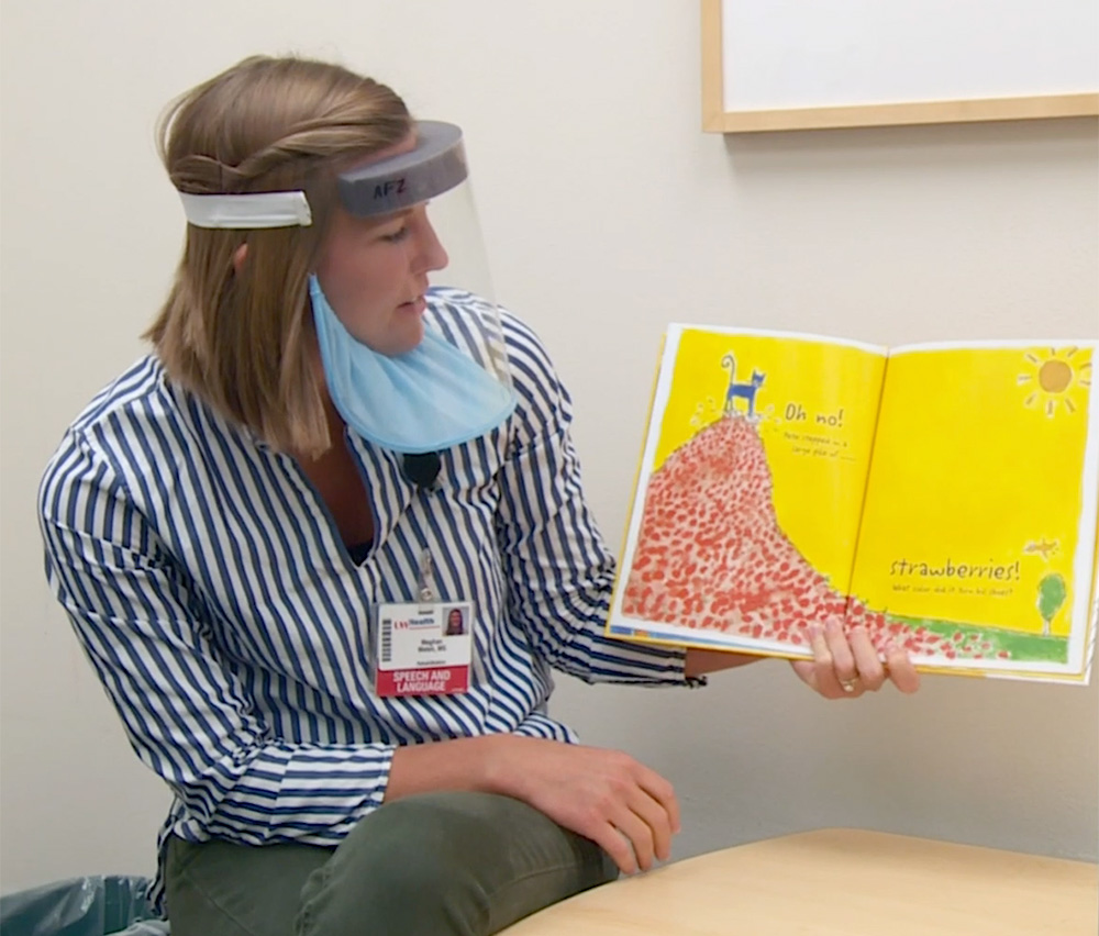 Meghan Welsh, a UW Health speech therapist, uses the new Badger Shield+ during a therapy session.